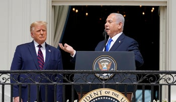 Israeli Prime Minister Benjamin Netanyahu speaks as President Donald Trump looks on, during the Abraham Accords signing ceremony, the White House, September 15, 2020.