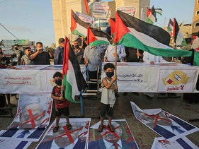 Palestinians protest in Rafah in the southern Gaza Strip against Israeli normalization deals with the United Arab Emirates and Bahrain on September 15, 2020.