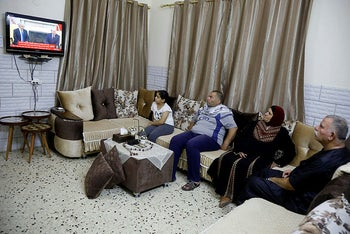 Palestinians watch TV broadcast before of the White House signing ceremony, in Tubas in the Israeli-occupied West Bank September 15, 2020.
