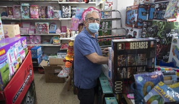 """Michael Colp at his toy and stationery store in Ra'anana. """"We're doing this now because it's convenient timing for Bibi [Netanyahu], and only for him. We're serving him, he's not serving us."""""""