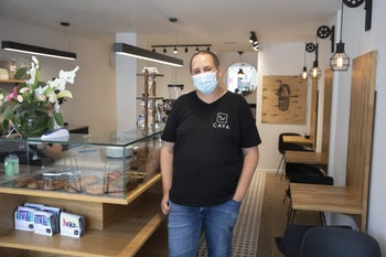 Gabi Gluck opened the doors to his new Ra'anana café, Caya, the day the country's leaders officially approved the coronavirus lockdown.
