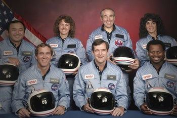 The crew of the space shuttle Challenger prior to their flight on January 28, 1986. Schoolteacher Christa McAuliffe is second from left in the back row.