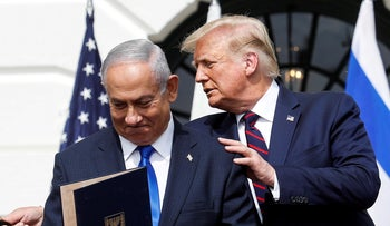 Israel's Prime Minister Benjamin Netanyahu stands with U.S. President Donald Trump after signing the Abraham Accords at the White House, September 15, 2020