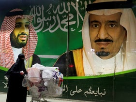 A banner showing Saudi King Salman, right, and his Crown Prince Mohammed bin Salman in Jeddah, Saudi Arabia