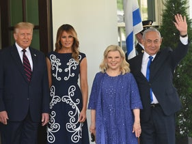 US President Donald Trump and First Lady Melania Trump welcome the arrival of Israeli Prime Minister Benjamin Netanyahu and his wife Sara at the White House on September 15, 2020