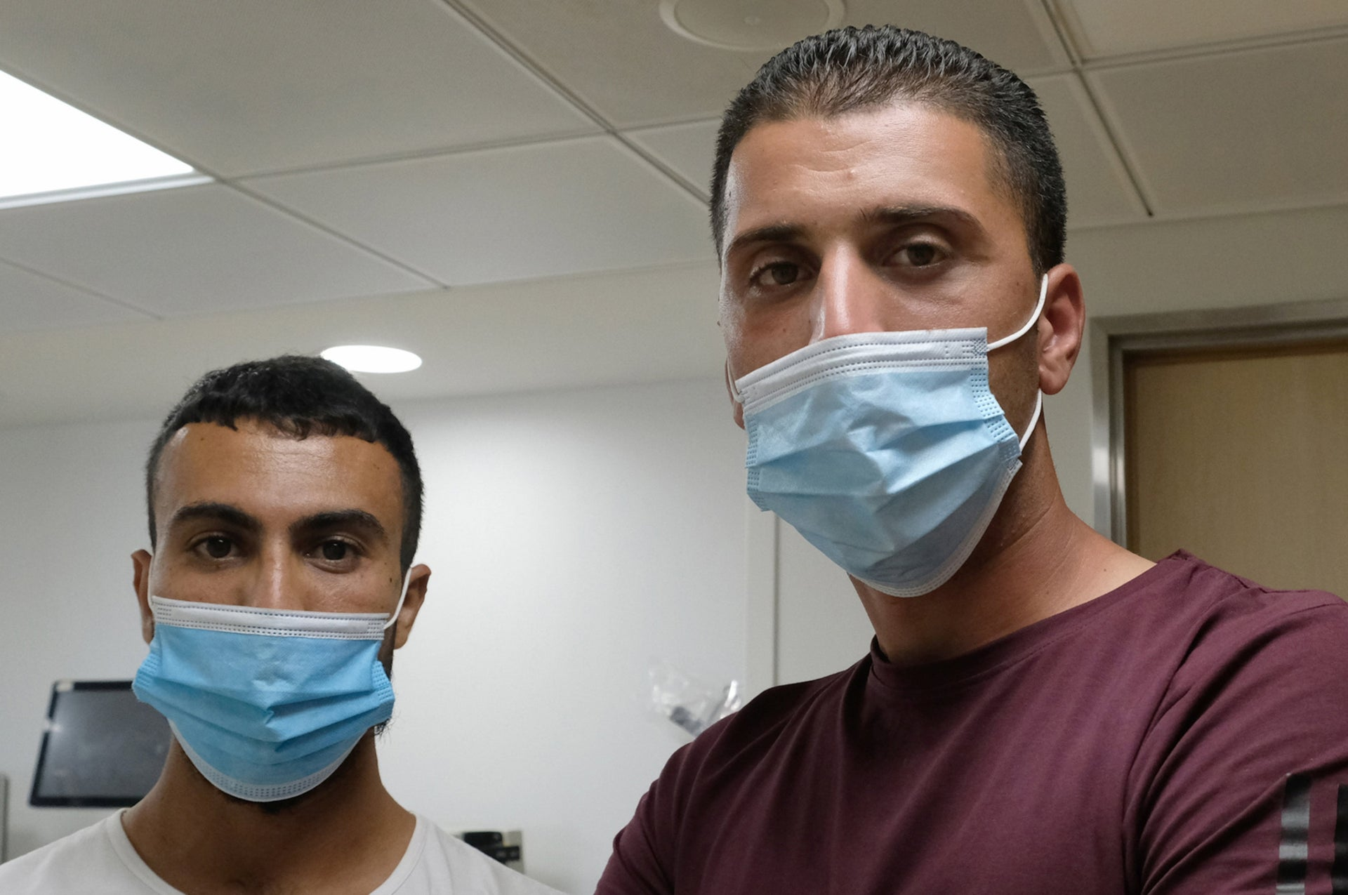 Anas Jabarah, left, brother of Abd al-Rahman, shot by Border Police, with Amid Hamadan, whose sister Tala was due to marry the wounded man this month.