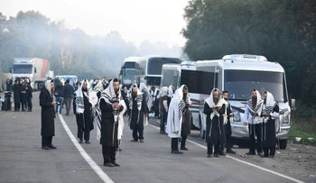 Jewish pilgrims pray on the road while stuck between Belarusian and Ukrainian border crossings, September 16, 2020.