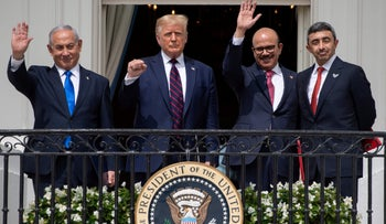 )Israeli Prime Minister Benjamin Netanyahu, US President Donald Trump, Bahrain Foreign Minister Abdullatif al-Zayani, and UAE Foreign Minister Abdullah bin Zayed Al-Nahyan wave from the Truman Balcony at the White House after they participated in the signing of the Abraham Accords where the countries of Bahrain and the United Arab Emirates recognize Israel, in Washington, DC, September 15, 2020.