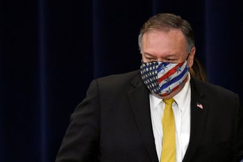 Secretary of State Mike Pompeo walks off of the stage following a news conference at the State Department in Washington, Wednesday, August. 19, 2020