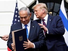 Benjamin Netanyahu stands with U.S. President Donald Trump after signing the Abraham Accords, on the South Lawn of the White House in Washington, U.S., September 15, 2020.