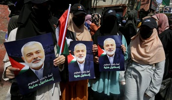 Women hold pictures depicting Hamas' top leader, Ismail Haniyeh, during his visit at Ain el Hilweh Palestinian refugee camp in Sidon, Lebanon September 6, 2020.