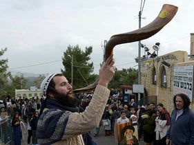 A rabbi blows a shofar in 2017.
