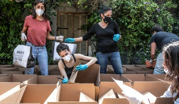 Packing food for the needy in Tel Aviv during the coronavirus pandemic, April 2020.