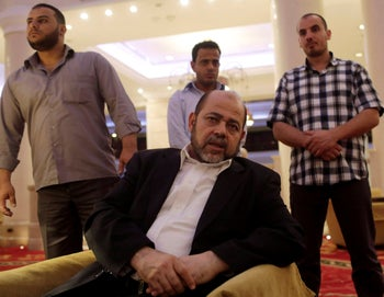 Moussa Abu Marzouk talks during an interview with Reuters in Cairo, Egypt, August 9, 2014.