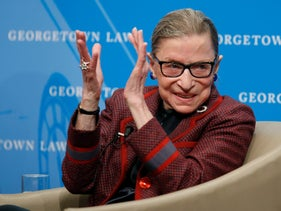 File photo, Supreme Court Justice Ruth Bader Ginsburg applauds after after she spoke about her life and work during a discussion at Georgetown Law School in Washington, April 6, 2018.