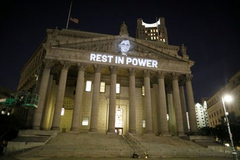 An image of Associate Justice of the Supreme Court of the United States Ruth Bader Ginsburg is projected onto the New York State Civil Supreme Court building in Manhattan, September 18, 2020.