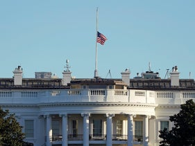 An American flag flies at half-staff over the White House in Washington, Saturday, September 19, 2020