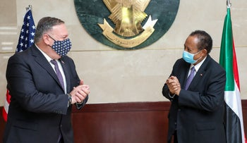U.S. Secretary of State Mike Pompeo greeting Sudanese Prime Minister Abdalla Hamdok in Khartoum, August 25, 2020.