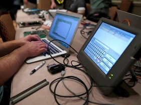 FILE PHOTO: A hacker tries to access and alter data from an electronic poll book during a hacker convention in Las Vegas, Nevada, July 29, 2017.