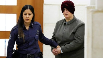 Malka Leifer is brought to a courtroom in Jerusalem. Leifer is wanted in Australia for 74 charges of sexual assault and the country's request for her extradition has been delayed for years.