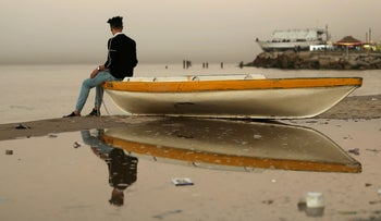 For illustration: A Palestinian man sits on a boat at the beach in Gaza City on January 11, 2018.