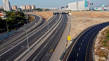 An aerial view taken near Netanya shows an empty highway after the authorities imposed a series of new measures meant to curb the spread of the novel coronavirus, on September 18, 2020.