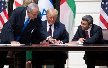 Prime Minister Netanyahu, U.S. President Trump, and UAE Foreign Minister bin Zayed Al-Nahyan, all maskless, at the Abraham Accords signing at the White House in Washington, DC, September 15, 2020