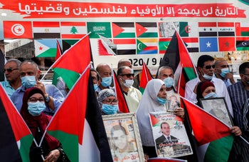 """""""History will glorify all but those faithful to Palestine and its cause."""" Palestinians protest the UAE's and Bahrain's decisions to normalize relations with Israel, Nablus, September 15, 2020."""