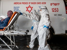 Magen David Adom workers are seen pushing a patient at shaare Zedek Hospital in Jerusalem, September 15, 2020