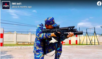 Screenshot from Israel Weapons International Facebook account showing a soldier in the Vietnamese navy practising with an Israeli Tavor assault rifle