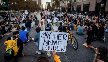 Protesters kneel as they demonstrate in Los Angeles, on September 23, 2020, following a decision on the Breonna Taylor case in Louisville, Kentucky