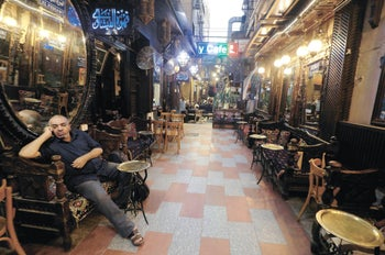 A man sitting at a deserted cafe in Old Cairo, Egypt, July 2020.