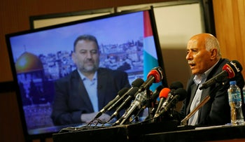 Senior Fatah official Jibril Rajoub, in the West Bank city of Ramallah, attends by video conference a meeting with deputy Hamas chief Saleh al-Arouri (on screen from Beirut), July 2, 2020