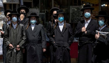 Young ultra-Orthodox men in a Jerusalem neighborhood. 5 July 2020