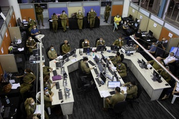 Soldiers work in a situation room at the headquarters of the Home Front Command, in Ramle, Central Israel, August 25, 2020.