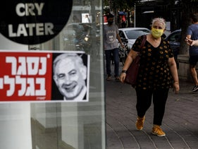 A shuttered store in central Tel Aviv, September 15, 2020. The sticker sports a picture of Netanyahu (R) and the slogan: 'You're here because of me.