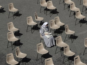 A nun awaits the pope's general audience at the Vatican this month.