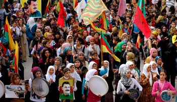 Protesters carry pictures of Abdullah Ocalan, the jailed leader of the Kurdistan Workers' Party (PKK), during a demonstration in support of Kurdish fighters and the besieged citizens of the Syrian town of Kobani and against the Islamic State, in Aleppo's Kurdish neighborhood of Sheikh Maksoud, November 1, 2014.