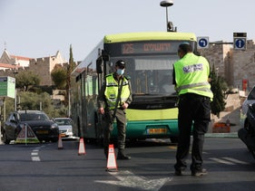 A bus waits in traffic at a police checkpoint during the second coronavirus lockdown, Jerusalem, September 21, 2020.
