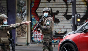 French soldiers patrol after four people have been wounded in a knife attack near the former offices of satirical newspaper Charlie Hebdo, Paris, September 25, 2020.