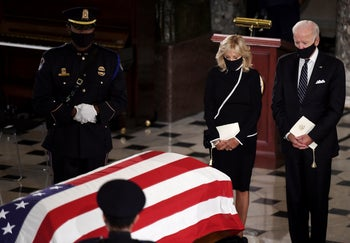 Democratic presidential candidate former Vice President Joe Biden and his wife Jill Biden, pay their respects as the flag-draped casket of Justice Ruth Bader Ginsburg lies in state at the U.S. Capitol, in Washington, D.C., September 25, 2020.