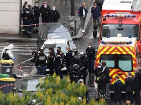 French police and forensic officers inspect the scene of an attack near the former Charlie Hebdo offices by a man wielding a knife in Paris, September 25, 2020
