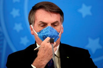 Brazilian President Jair Bolsonaro with a face mask in the press in Brasilia, Brazil, March 20, 2020.