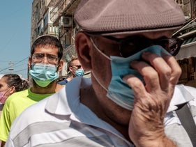 Residents of Jerusalem wearing masks to prevent the spread of coronavirus, during a second nationwide lockdown, September 25, 2020.