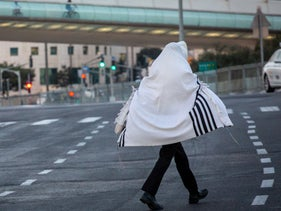 A pedestrian walks in Jerusalem on September 25, 2020.