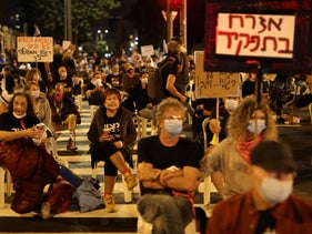 Protesters maintain their distance at a demonstration against Prime Minister Benjamin Netanyahu outside his official Balfour Street residence in Jerusalem, September 24, 2020.
