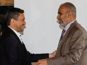 Abdulkader al-Murtada, Head of the Houthi prisoner exchange committee shakes hands with Hadi Haig, Head of the Yemeni government delegation, at the fourth meeting of the Yemen prisoners' exchange committee, in Glion, Switzerland, September 27, 2020.
