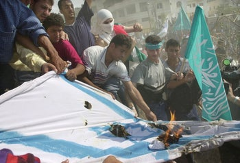Palestinians burning an Israeli flag in Gaza in 2000.