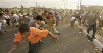 Palestinians fleeing during a clash with the Israeli army in southern Gaza, 2000.