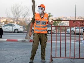 A Home Front Command soldier at a drive-through coronavirus testing station in Jerusalem, September 2020.
